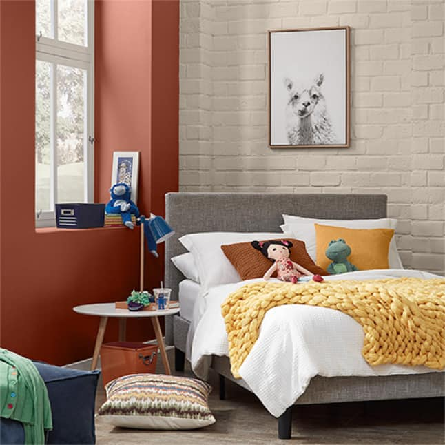 Picture frame shown against a painted interior brick wall