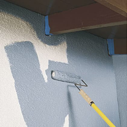 Blue paint applied with a roller to an interior stucco wall