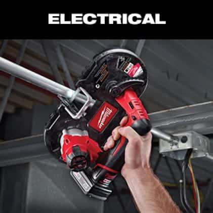 Electrician cutting conduit overhead.