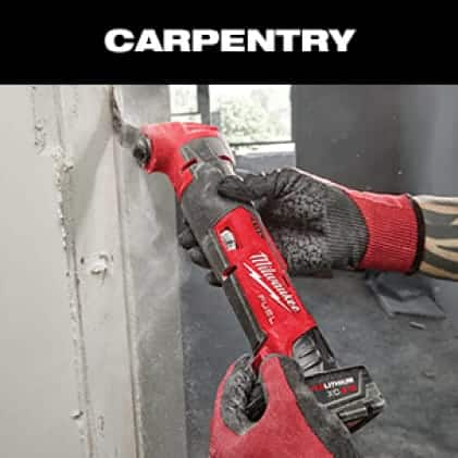 A man wearing gloves uses an M12 FUEL Oscillating Multi-Tool to cut drywall.