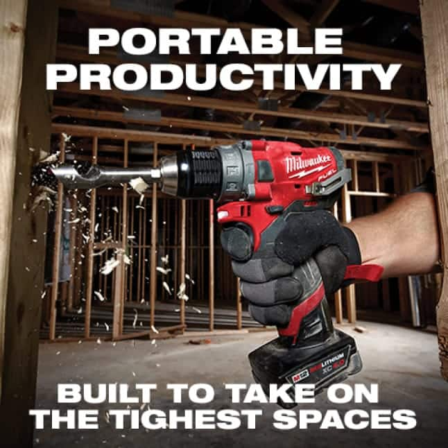 """Man wearing glove uses an M12 FUEL 1/2"""" Drill Driver to drill into wood beam"""