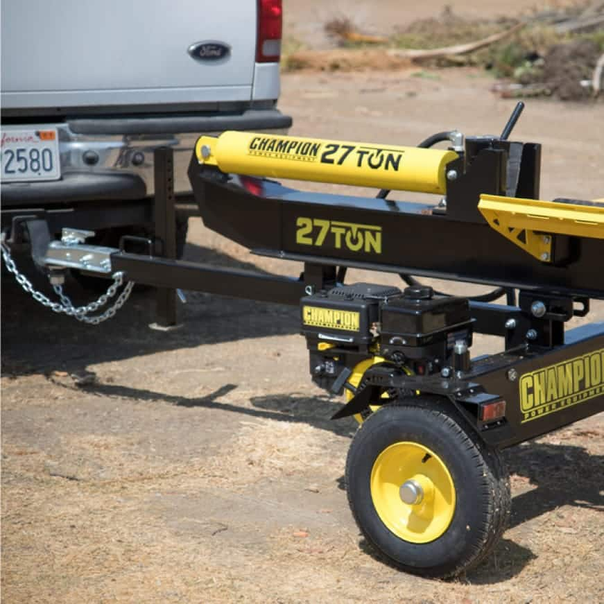Lifestyle image of log splitter being towed by a truck