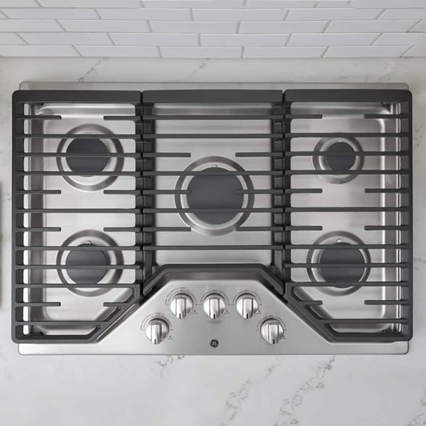 A top-down view of the cooktop shows its grates