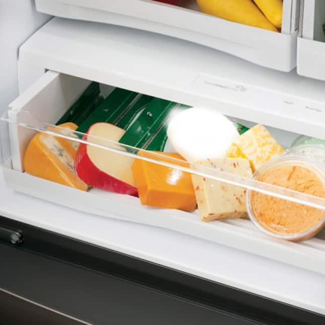 A variety of fresh cheeses have been stored in the wide climate-controlled bottom drawer.