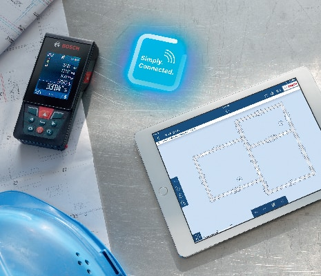 Bosch GLM400C next to tablet showing connectivity to MeasureOn app.