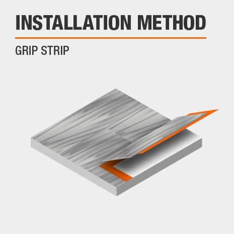 Luxury Vinyl Plank flooring with grip strip installation.