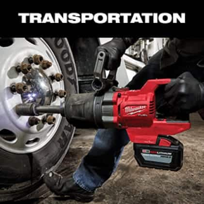 "Man uses both hands on M18 FUEL 1"" D-Handle High Torque Impact Wrench to remove lug nut."