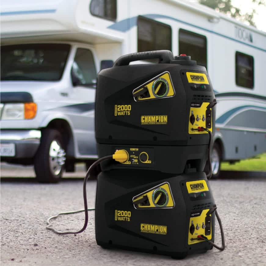 Lifestyle image of two stacked inverter generators in use with a parallel kit powering an RV