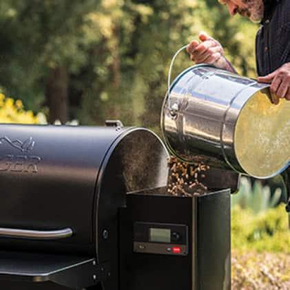 Traeger Grills - Hardwood poured into hopper