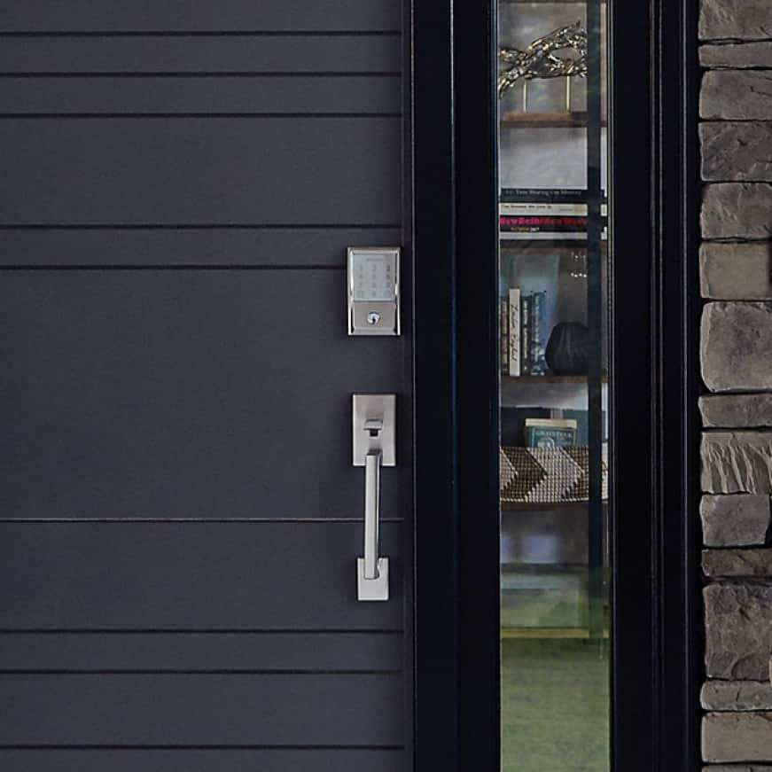 Schlage Encode wifi smart lock in Satin Nickel on black front door.