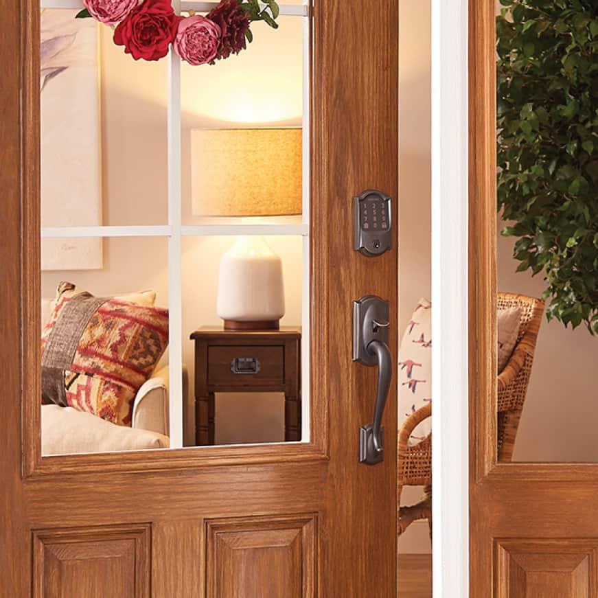 Schlage Encode wifi smart lock in aged bronze on front door.