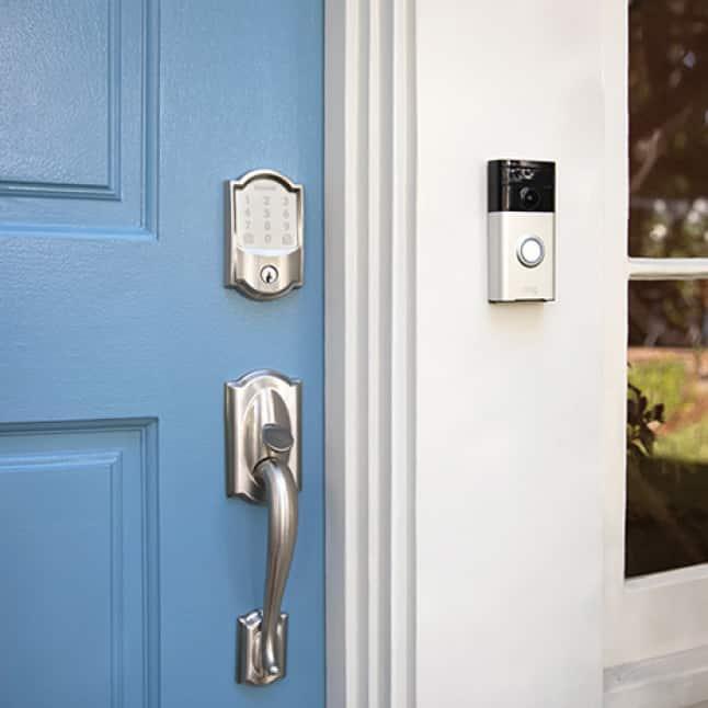 Schlage Encode wifi smart lock in satin nickel on blue front door with Ring Doorbell.
