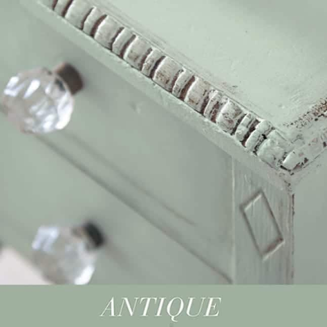 End-table painted to a light green chalk color, shown with an antique look