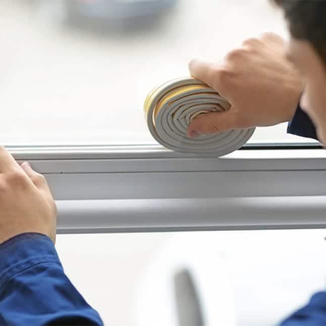A man installs his AC unit