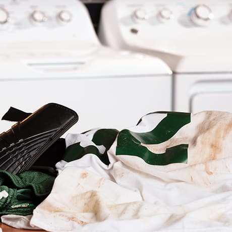 Dirty Clothes in front of washer/dryer