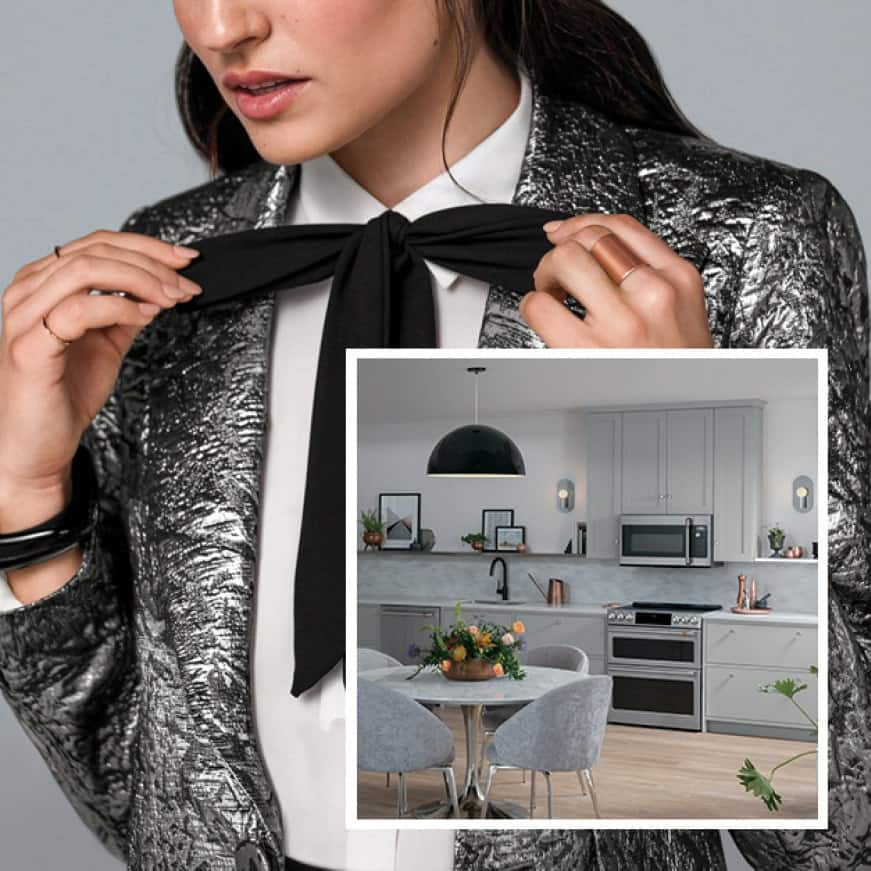 An image of a kitchen with sleek Cafe appliances is superimposed over a woman dressed in trendy clothes that match the decor.