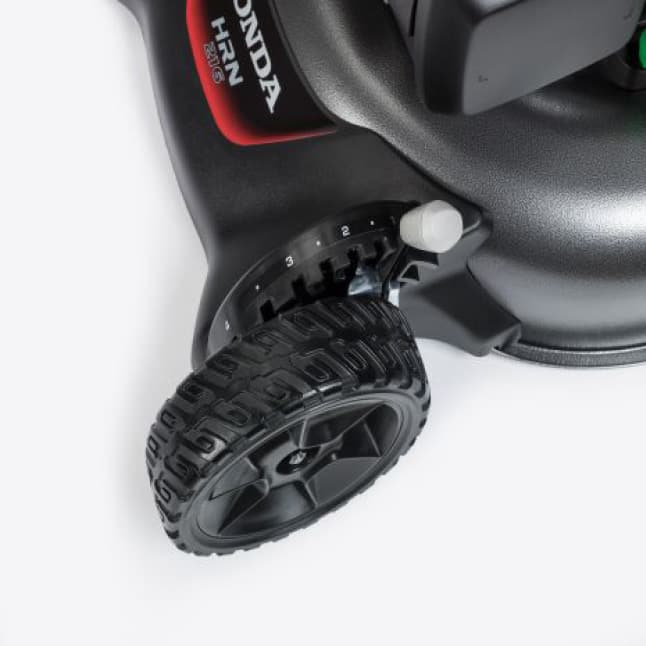 Close-up view of the wheel, highlighting the lever that adjusts heights of the wheel.
