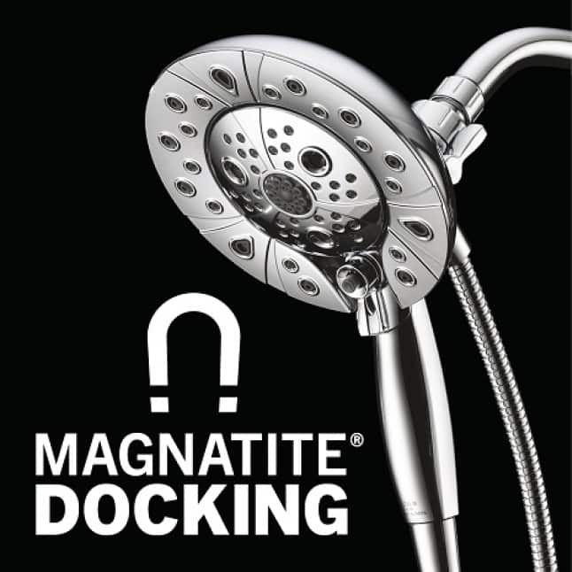 """Image is has a black background with a docked hand shower into the showerhead base with copy """"MagnaTite Dock"""" and an icon of a magnet"""