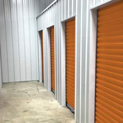 Metal storage room door painted orange
