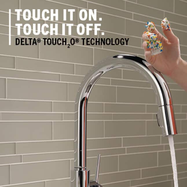 messy hand turning on a faucet by touching the spout using their wrist