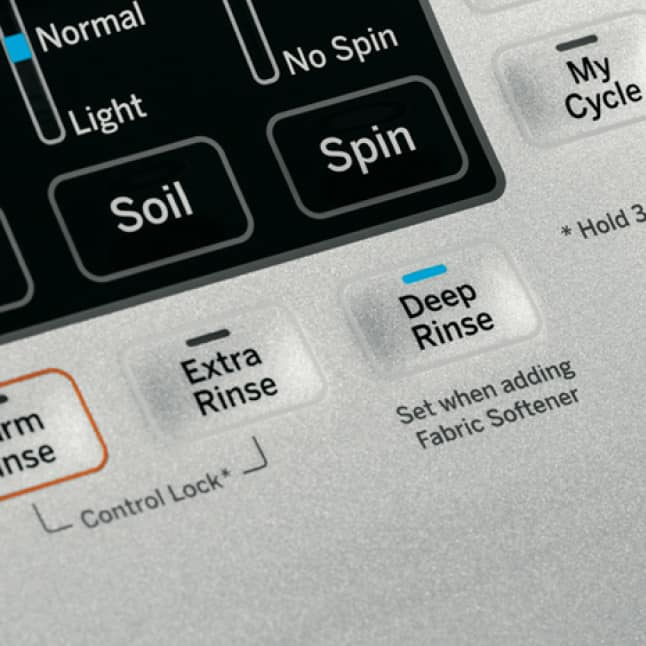 Warm Rinse, Deep Rinse and Extra Rinse options on the control panel of a GE washer