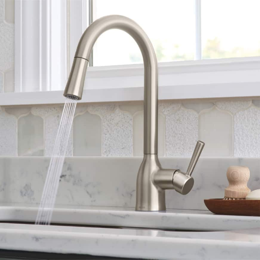 The graceful design epitomizes the transitional style of the Adler pulldown kitchen faucet. An elegant base and handle leave a lasting impression.