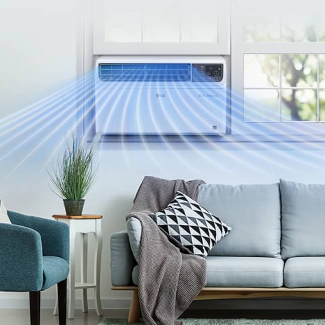 Room with sofa and DUAL inverter window air conditioner showing air flow