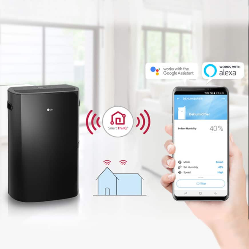 Image of woman's hand holding smartphone to control dehumidifier with LG ThinQ app, Google Assistant and Alexa logos.