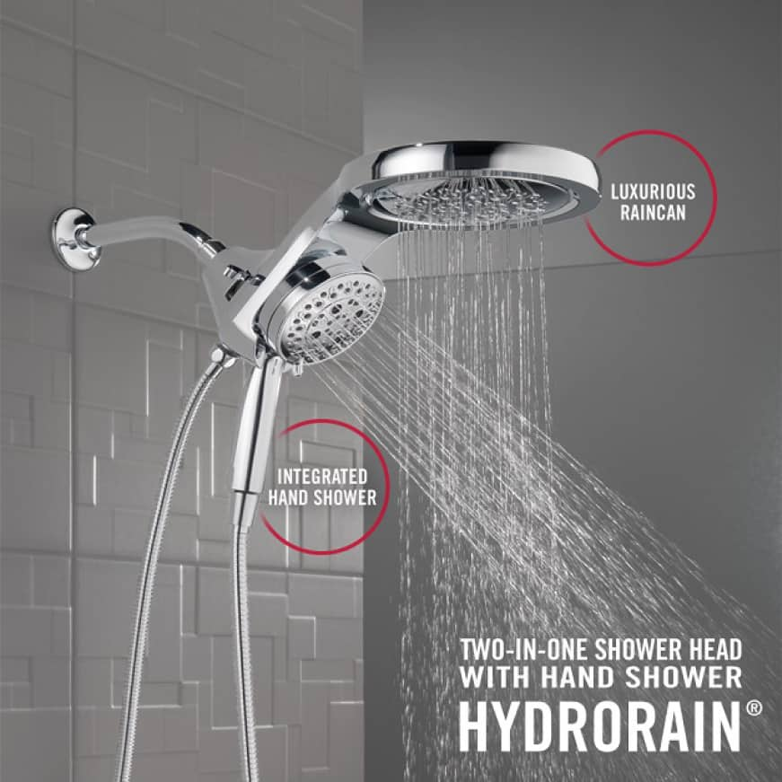 """Image is an in-context view of the showerhead installed on a shower wall with water running and copy """"Luxurious raincan"""" and """"Integrated Hand Shower"""""""