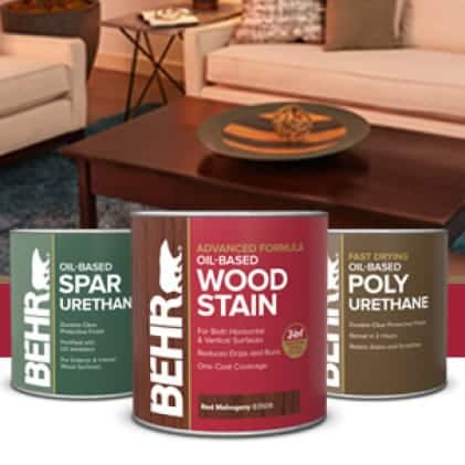 Behr's interior stain program can shot images with a stained brown coffee table in background. Dark Walnut B4502