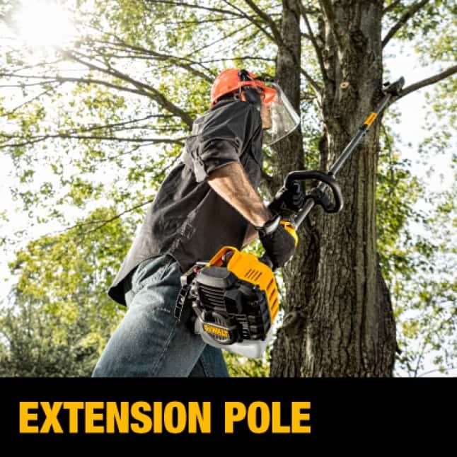 Man pruning yard with Dewalt gas Pole saw