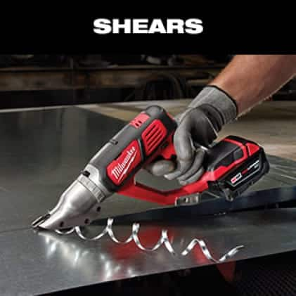 Man wearing work gloves makes a straight cut in sheet metal with an M18 Doule Cut Shear.