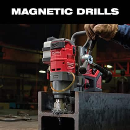 A man wearing work gloves uses the M18 FUEL Magnetic Drill to cut a hole in steel beam.
