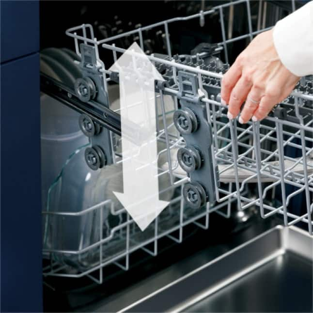 Woman pulling out top rack to adjust it to her preferred height. Arrow overlays indicating the rack can go up and down.