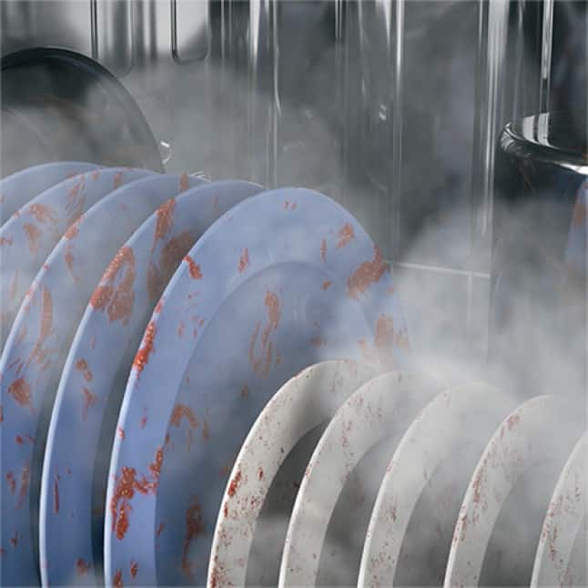 Tight shot of dishes in the dishwasher with steam surrounding them to sanitize dishes