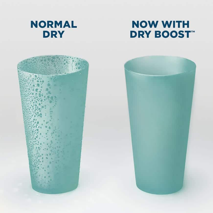 Two cups sit next to each other after running through separate cycles. The normal-dry cup still has water droplets, but the dry boosted cup is dry.
