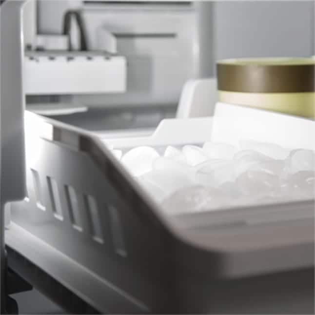 Icemaker filled with ice inside refrigerator
