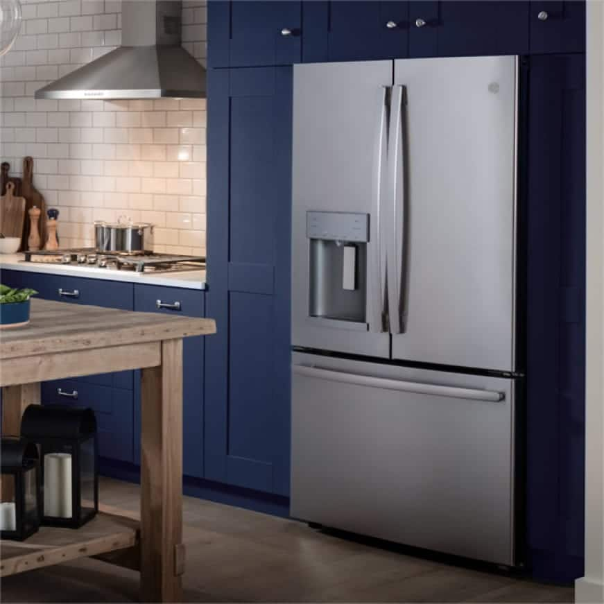 Photo of refrigerator in a kitchen set.