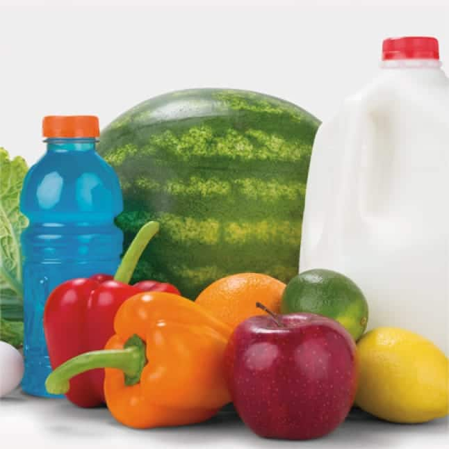 Image of large watermelon, gallon of milk, and various vegetables.
