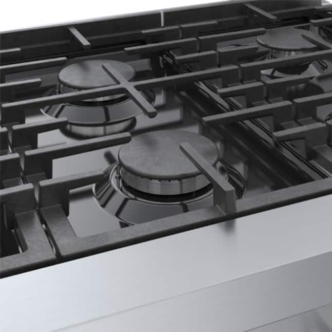 Close up view of easy to clean porcelain enameled cooking surface.
