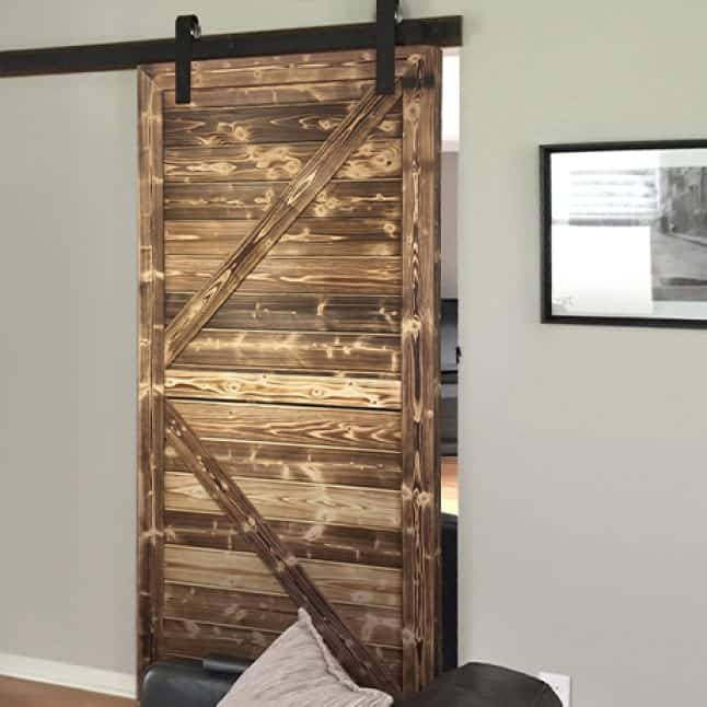 Interior decorative sliding barn door made with Natural Charred Project Boards