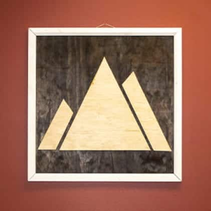 Wall art depicting an abstract mountain range made from DimensionsTM underlayment panels