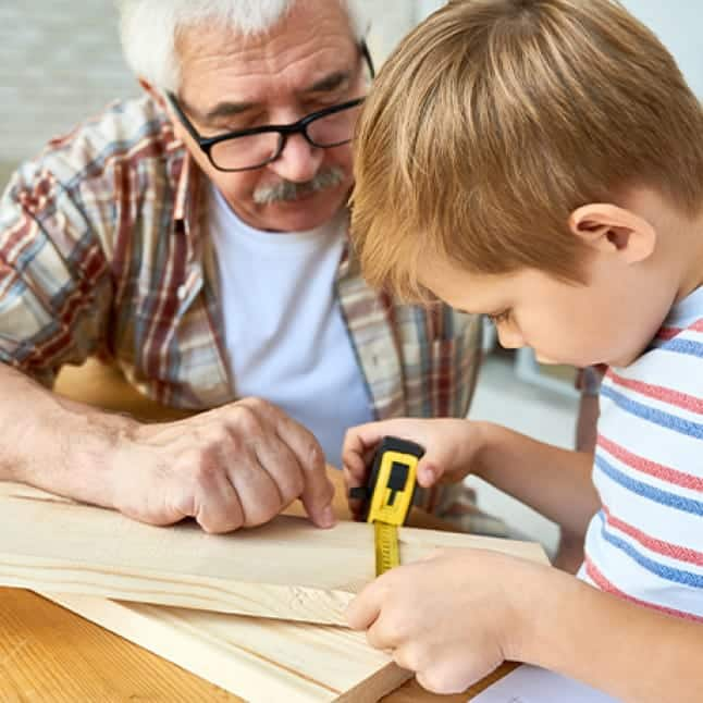 Grandpa and grandson doing a project together using DimensionsTM Project Boards