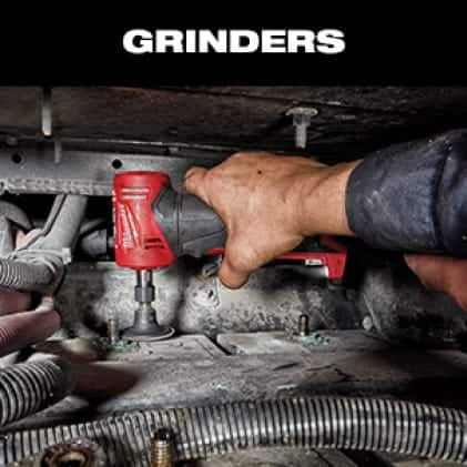 A man uses the M12 FUEL Right Angle Die Grinder in confined space to remove gasket seal.