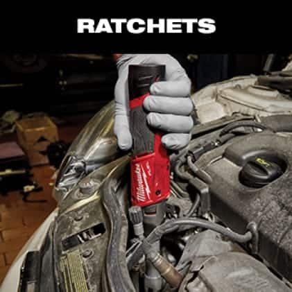"""Automotive mechanic uses the  M12 FUEL 3/8"""" Extended Reach Ratchet for engine bay maintenance"""