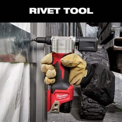A man wearing a work glove uses the M12 Rivet Tool to drive a stainless steel rivet into sheet metal.