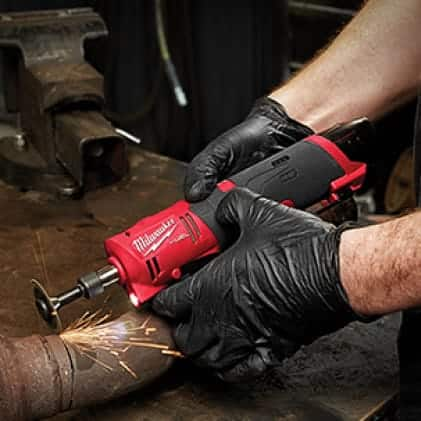 "Metal Fabricator wearing gloves uses the M12 FUEL 1/4"" Straight Die Grinder to cut a pipe."