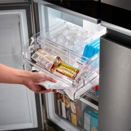 Fill the ice bin with ice or stash small frozen snacks and popsicles
