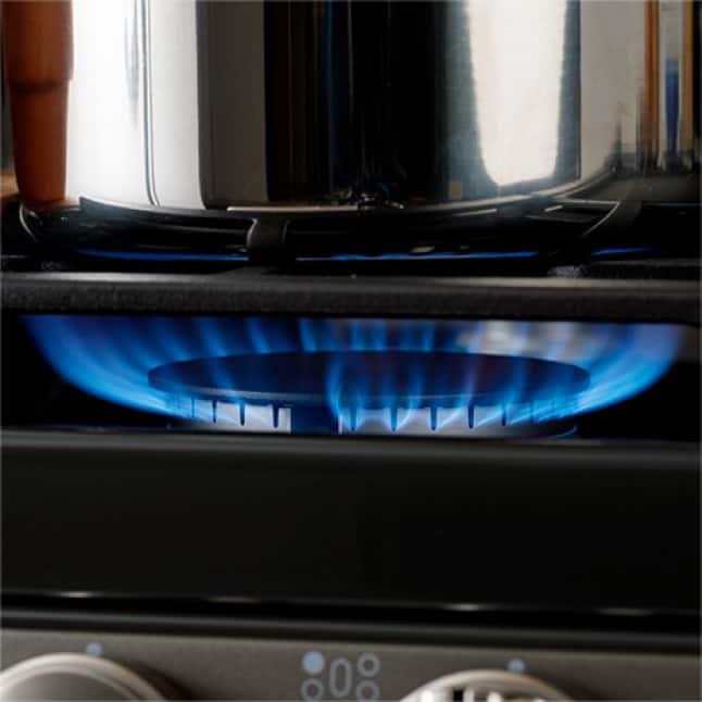 Power boil burner on with saucepan over the flame