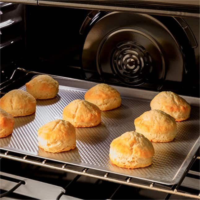 Biscuits baking in a convection oven